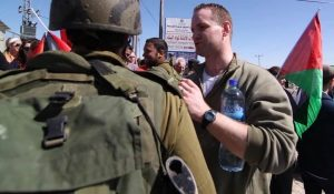 Pastor John Moyle speaking with Israeli soldiers at the Palestinian demonstration