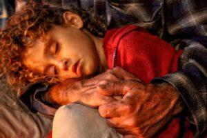 Israeli Grandpa holding grandson